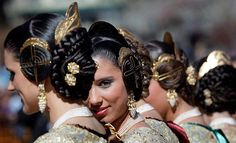 A group of 'falleras' wearing traditional costumes at the start of Las Fallas festival. Valencia, Spain.