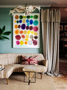 Hang a statement-making art piece to add color to your living room. Paint Colors For Living Room, Rugs In Living Room, Home And Living, Living Room Decor, Rug Over Carpet, Hangout Room, Curved Sofa, Hotel Interiors, Wet Rooms