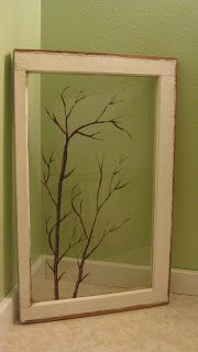 Old window with tree sketch on glass.
