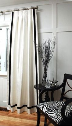 on color splash they did whiteblack curtains but the 4 border went all the way around like a frame loved it it also hung with a ripple fold