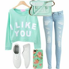 Sweat shirt and boyfriend jeans and white shoes with a floral phone case and a teal blue purse
