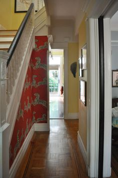 I love this wallpapered stair case.