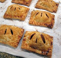 Hand-Held Apple Pies///These individual apple pies are made with a flaky all-butter crust and a chopped apple filling. Make the filling the day before and baking day will be a snap.  Prepare the pies and freeze half of them for another day.