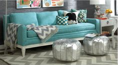 notice the throw over the arm and seat of the couch three pillows on other side side table vignette