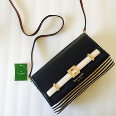 """💫HP💫Kate Spade Striped Cross body handbag Leather and canvas material. Color : Black & White and pink interior. Can be worn as clutch or cross body!  Interior zipper pocket and one large slip pocket Approx : 10""""x6""""x2"""" (LxHxD) with a 20"""" strap drop.  Gold printed kate spade new york logo Kate Spade dustbag included, magnetic snap closure kate spade Bags Crossbody Bags"""