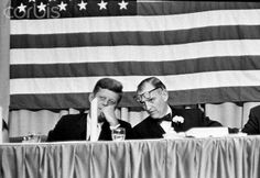 11-21-63 - Congressman Albert Thomas talks with President Kennedy at a testimonial dinner in Houston's Coliseum - the last event in a busy six-hour visit to the city.