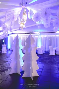 This Corporate Christmas Party was one filled with wonder. Beautiful crisp blue tones + silver elements on a white backdrop made for a gorgeous event. Atmospheric lighting with strong elements of winter repeated throughout the decor, transported guests into a space that was mysterious, ethereal and inspiring. - www.enchantedempire.com.au
