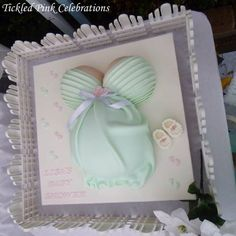 Enchanted Garden Baby shower styling we created with soft mint green and white colours - yummy pregnant belly cake created by the talented Michelle from Miss Shells Cakes! www.tickledpinkcelebrations.c.au