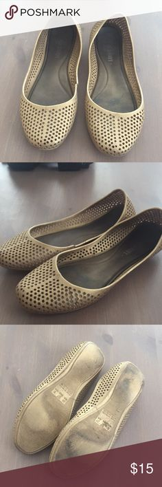 Gold Rubber Flats made in Brazil Well loved good flats from old navy. They are really comfortable and cute! Only selling because they are warm weather shoes and I moved up north. Old Navy Shoes Flats & Loafers