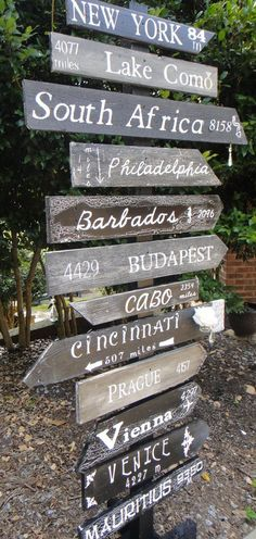 Customized Key West Style Distressed Wooden Mile Marker - my sis-in-law does these! Super cool!: