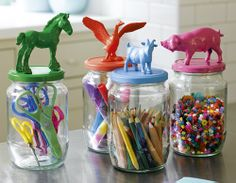 Repurpose food jars for art supplies! Wash, dry, glue animal to top, or screw in drawer knob, spray paint, let dry, fill with supplies,  and VOILA!