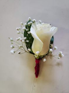 White roses, baby's breath, green leaves, pink trim. Pink Boutonniere, Boutonnieres, Baby's Breath, Corsages, White Roses, Green Leaves