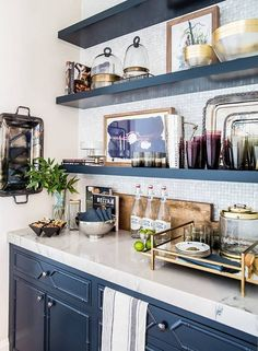 open shelving in kitchen with navy cabinets