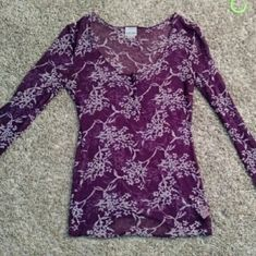 Free People Floral Burnout Henley in Purple Intimately Free People henley that can be worn all year. Sheer purple fabric with pink floral accents and a button front opening at the chest. Perfect for layering! No tears or stains, but some pilling in the underarm area as pictured above Free People Tops