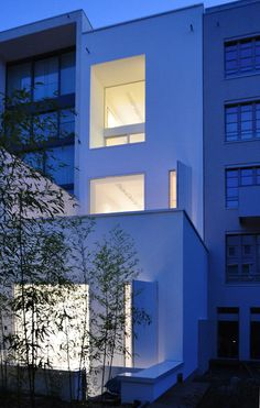 """The found structure of an unfinished townhouse within the context of the urban development of central Berlin Friedrichswerder is based on the guidelines """"planwerk innenstadt"""" was radical reconsidered and dismantled. The material of the facade, glossy white aluminium panels, highlights the significan"""