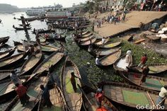 Ferry boats by a landing stage next to Sadarghat Boat Terminal.