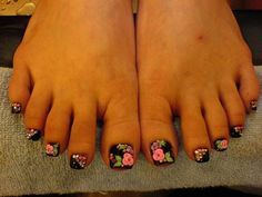 Pretty black pedi with pink, purple and green flowers #nailart