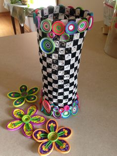 My first quilling project almost complete! Whimsical flowers and a checkerboard vase.