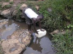 Unsanitary water source in Rwanda. Only 74 percent of people in Rwanda have access to safe drinking water.