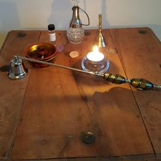 A gorgeous vintage  metal (possibly polished steel) and glass candle snuffer that will look amazing on any altar or in any candle loving home. The glass beads are stunning!