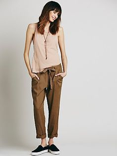 Relaxed Crop Tie Pant | Slouchy lightweight linen trousers with a tie waistband and pleat detailing featuring rolled cuffs.  Four-pocket style with a hidden button fly and a double hook and eye closure.