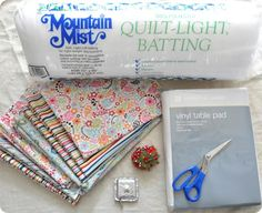DIY: Patchwork Picnic Blanket. Quilt a waterproof picnic blanket using patchwork, batting, and a vinyl tablecloth. I totally had an idea to do this and now here's a tutorial! hooray!