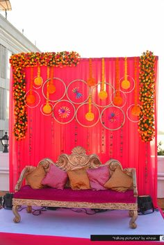 Backdrop decorated with clustered floral arrangement hoops, topiaries and handmade ethnic strings. | weddingz.in | India's Largest Wedding Company | Indian Wedding Decoration Inspiration | More