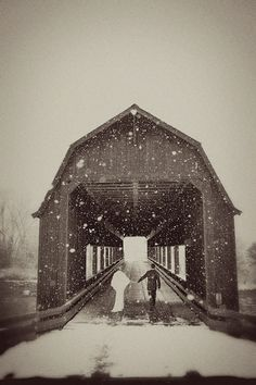 bride-and-groom-walking-hand-in-hand-into-a-snowy-barn-covered-bridge-James-Christianson-Photography.jpg 600×900 pixels
