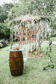 Rustic chic wedding altar with ribbons, flowers and quote cut-out // A Sparkly Sendoff: Issac and Charlotte's Soiree at Suburbia