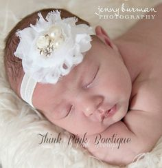 This beautiful headband features a shabby chic flowers topped with a pearls and rhinestones jeweled cneter that gives it a romantic vintage look. It has been placed on a soft and stretchy matching headband. The flower are felt backed for comfort. Simple and yet elegant, sure to be a real head turner!! Pair it with one of our adorable lace petti rompers for a complete look. Perfect for newborn pictures, baby blessings, baptisms, weddings, and special occasions!