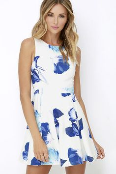 Slip into the Day and Foliage Blue and Ivory Floral Print Dress for a stroll in the park, a swanky garden party, or your next wedding invite! Blue blossoms cover textured knit as it shapes a sleeveless, darted bodice. Back cut-out sits above the pleated skater skirt. Exposed silver back zipper.