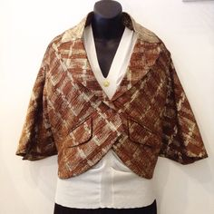 Marni brown and gold cropped jacket paired with Roberto Cavalli cream tank. Jacket size 42. Tank size small. Please call (949)715-0004 for inquiries.