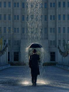 Man with Umbrella Under a Regional Rain Fotografie-Druck von Joseph Hancock bei AllPosters.de