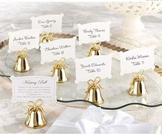 Great idea for a #50th golden anniversary - #gold bell place card holders with place cards.