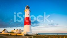 Colourful lighthouse watching over blue ocean panorama Dorset UK royalty-free stock photo