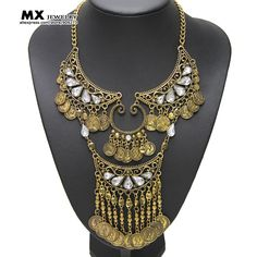 US $3.23  / piece x 12 pcs [US $6.66 / piece http://www.aliexpress.com/store/product/2015-latest-vintage-necklace-women-long-exaggerated-handmade-coin-charms-statement-necklaces-pendants-crystal-necklaces-NK1136/909273_32434903279.html; US $ 1.3 - 1.5 / piece http://canaworldwide.en.alibaba.com/product/60323605015-219828380/2015_Newest_Fashion_Indian_Short_Gold_Metal_Flower_Resin_Stone_Coin_Tassel_Statement_Necklace.html]