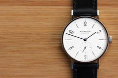 Nomos Tangente Datum Glashütte's Nomos has built quite the reputation for itself as one of the top choices for design-minded watch guys. The brand's Tangente Datum even received a Good. Cool Watches, Watches For Men, Men's Watches, Perfume, E 10, Looks Style, Men's Style, Design Awards, Fashion Watches