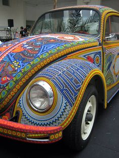 This 1990 Volkswagen Beetle received over 2 million glass beads along with beeswax to cover every inch of the car's exterior and the dashboard.