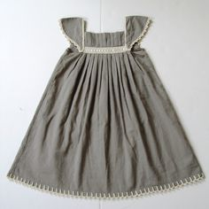 Aravore Childrens Party Dress.  Gorgeous dress in soft organic cotton voile w/ pleats and beautiful crochet detail on the sleeves and skirt, perfect for any special occasion. Gift boxed.  shop.wolfandbadger.com/childrenswear-party-dress-p-697.html