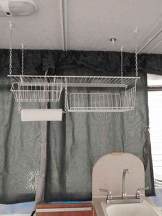 Hang a shelf system above your kitchen. | 44 Cheap And Easy Ways To Organize Your RV/Camper