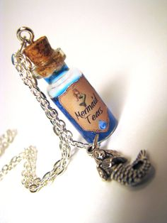"corked bottle of blue glittery mermaid tears & silver mermaid charm necklace with 24"" silver chain"