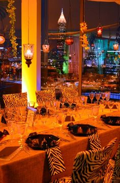 A South African themed party at Ventanas, a rooftop event space overlooking Midtown and Downtown Atlanta.