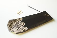 Large, Ceramic incense burner/holder. Made from white clay and covered black glaze. Gold bronze lace pattern. Great for yoga, meditation or aromatherapy. The incense burner is handmade and designed by me. It holds a long or short incense stick.  Size: approx. 11.5 x 4.5 Inches We send via priority mail (save envelope)  Please do not hesitate to contact me with any questions or to discuss a custom order.  Thank you for visiting our shop…