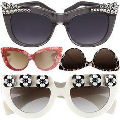 Diamante Sunglasses, Kurt Geiger; Feather Cat-Eyes Sunglasses, Charlotte Olympia by Linda Farrow; Curved Cat-Eye Sunglasses, Stella McCartney; Floral Sunglasses, Prada
