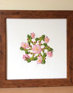 Framed embroidered picture of dog roses, by Ruth O'Leary