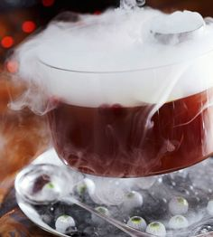 Ghoul's Punch ~~ Boring party drinks become spooky with the addition of dry ice. Place dry ice in a tall, heavy metal cup and set it inside a punch bowl. (Be sure the cup extends above the rim of the bowl.) Pour cold cider into the punch bowl and watch the fog drift from it. Place a tray beneath the bowl to catch any drips. Surround the eerie concoction with edible eyeball candies and black licorice jelly beans.
