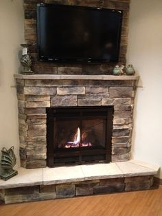 Corner fireplace with TV hung above with furniture layout. Description from pinterest.com. I searched for this on bing.com/images