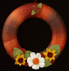 Yarn wreath with felt flowers. #YarnWreath #FallWreath
