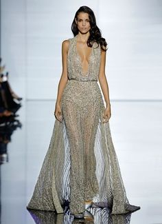 e36aae788aa ZUHAIR MURAD Shimmering bronze silk tulle jumpsuit with a plunging neckline  and cascading crystal and sequin