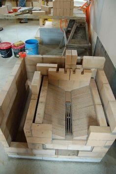 I am thinking this is the base for my firebox. I want to incorporate a fan ti push air up through the bottom 'vent' Wood Oven, Wood Fired Oven, Wood Stove Heater, Hydronic Heating, Rocket Stoves, Back Patio, Architecture Details, Home Projects, Firewood